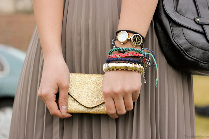 mini gold glitter clutch + arm party