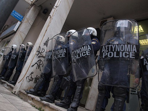 Greek riot police outside finance minister's political office - Thessaloniki, Greece
