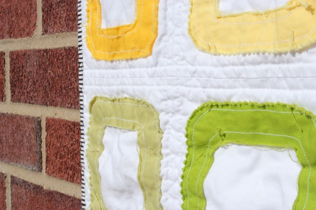raw edge pez baby quilt.