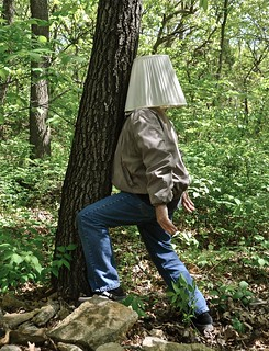 Portrait of a Hiker Who Constantly Bumped Into Trees Because He Insisted on Wearing a Lamp Shade on His Head