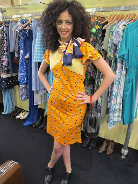 Vintage 1970s printed orange dress and printed silk scarf from Granny's Day Out.