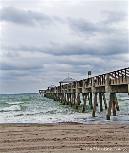 stormy pier by Alida's Photos