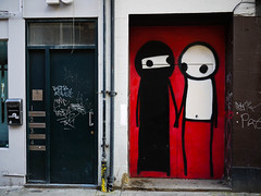 Red door, holding hands