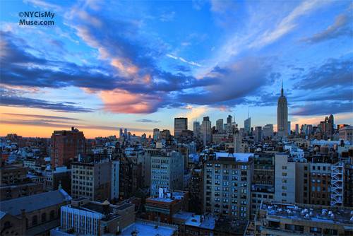 Gorgeous Clouds, jet trail and wide angle NYC skyline in the Late afternoon