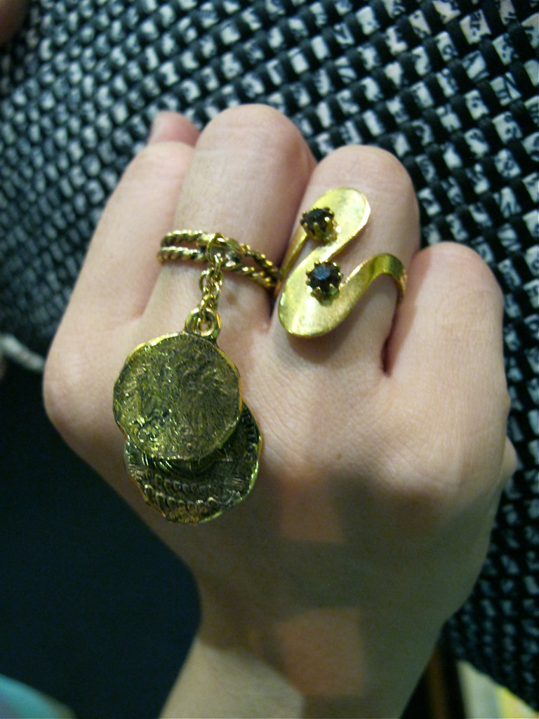 GDO loves big and loud rings: Left: 1960s gold-plated ring with dangling coin-like discs; Right: 1960s wwirly gold-toned rings with Swarovski crystals. Both New Old Stock (never worn).