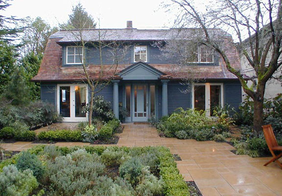 Landscape tiles take turns with shrubs and grasses in this entry.