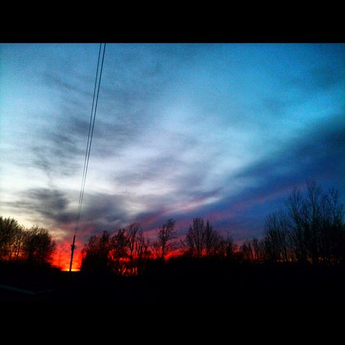 "#marchphotoaday day 13 a ""sign"" of warmer spring weather #sunset #sky #clouds"