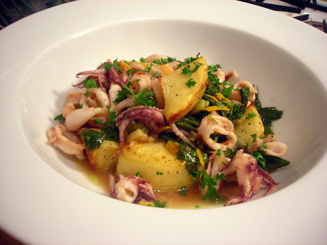 Olive oil-poached squid with orange zest, garlic and ramps, and crispy roasted potatoes