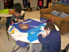 Grade one students creating posters for their PBL project