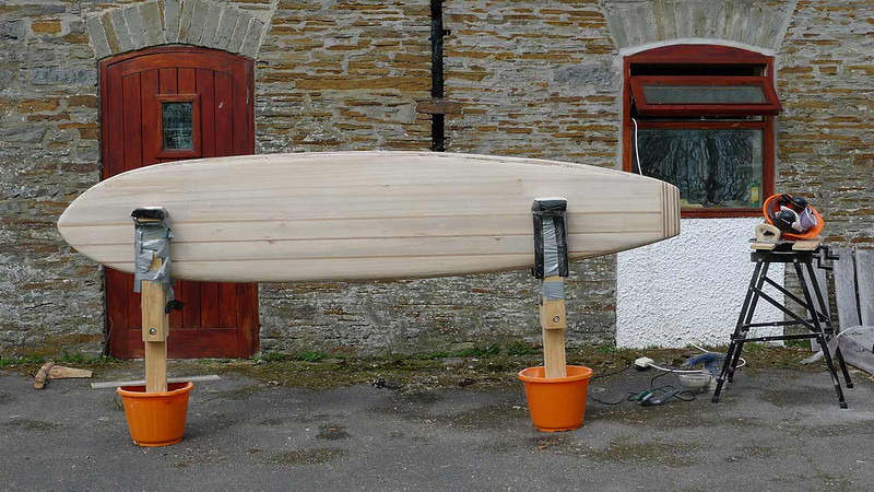9 Foot hollow wooden longboard outside the shaping room prior to fibreglass