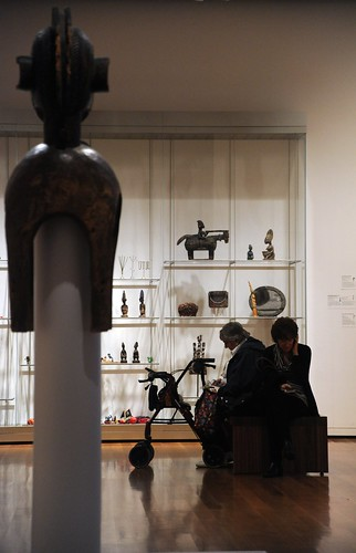 Museum still-life, African sculptures, patrons, walker, cell, Seattle Art Museum, Seattle, Washington, USA by Wonderlane