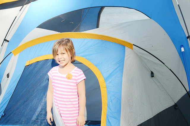 avery in front of tent