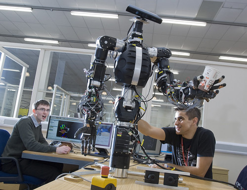 Demonstrating touch sensitivity of a robot grasping a paper cup