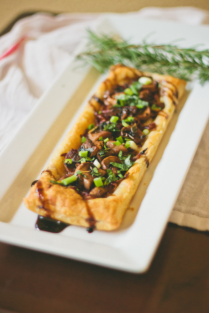 {caramelized onion-mushroom-goat cheese tart with balsamic-guinness reduction} via chevrons & éclairs