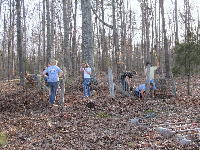 Longwood University Lambda Alpha Anthropology Honor Society students and members of the Primitive Technologies Club clean up the Redd Family plot at Starhope Church.