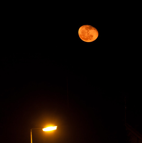 Orange Moon rising by Mick Hyde