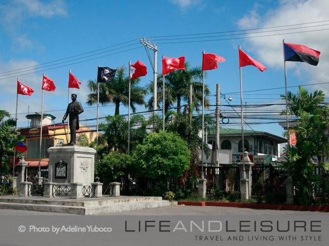 Katipunan flags and statue of Aguinaldo at Barasoain Church