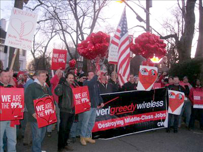 Members of CWA Local 1103 and 1105 gather at a Verizon Board Members house with a Valentine's Day Message.