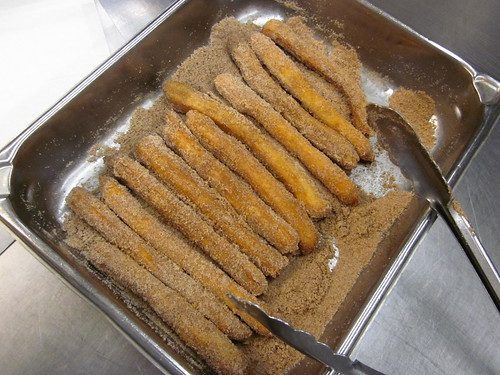 cinnamon sugaring churros