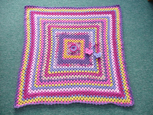 A beautiful Granny blanket made in the colours of pink, white and yellow! Stunning!