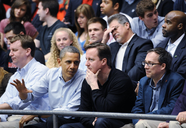 Barack Obama and David Cameron watch a basketball game