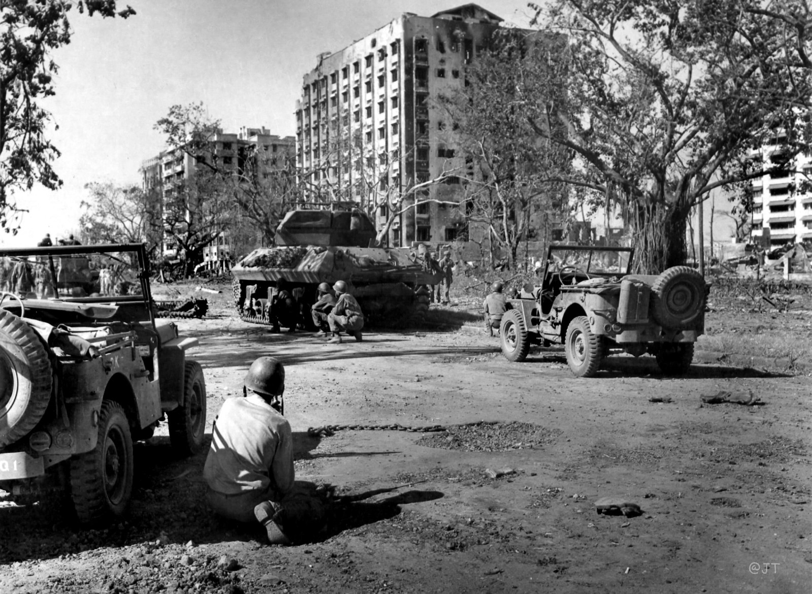 American Soldiers Taking Cover Behind Tanks As The Tanks Proceed Into The  City Down Dewey Blvd., (Roxas Blvd.), Manila, Philippines, Feb. 1945