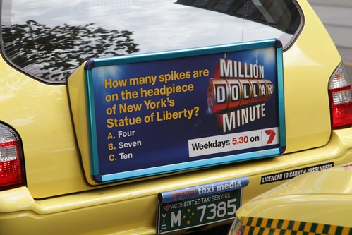 Back of taxi advertising from 'Rova Taxi Media'