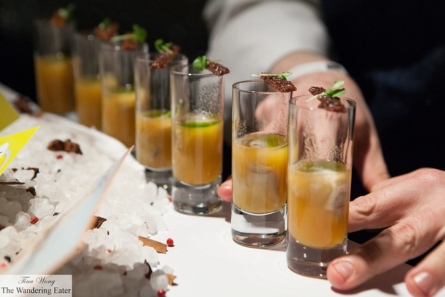 Smoked cantaloupe oyster shooters with mezcal topped with candied bacon and lemon basil by L&W Oyster (at VIP Lounge)