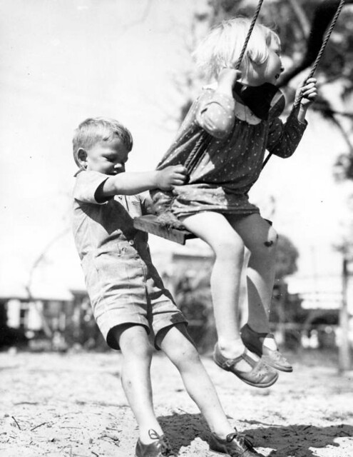 Children playing on swing at a FERA nursery - Green Cove Springs