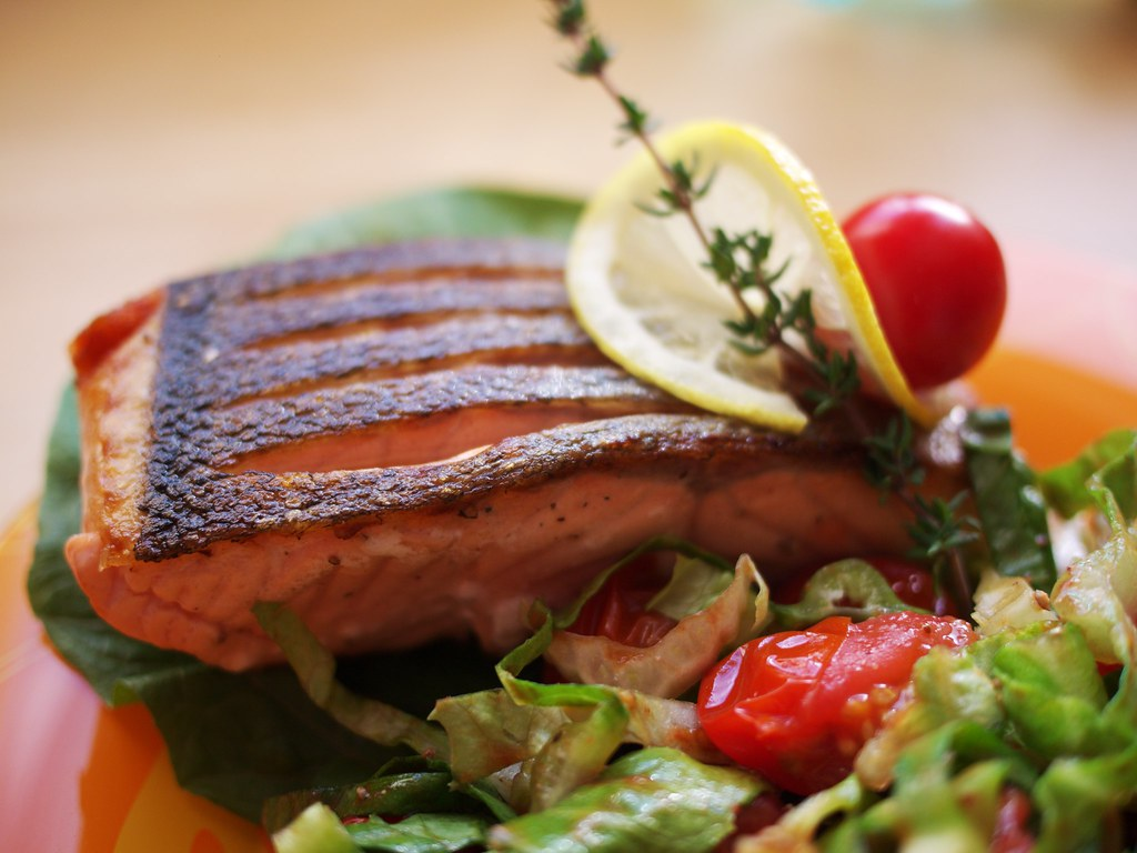 Pan-roasted salmon with lettuce and cherry tomatoes