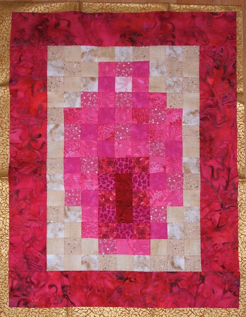 Wall hanging with gold binding