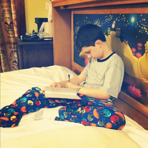 My little lefty journaling about his first day at Disney. In a really snazzy Murphy bed at that.