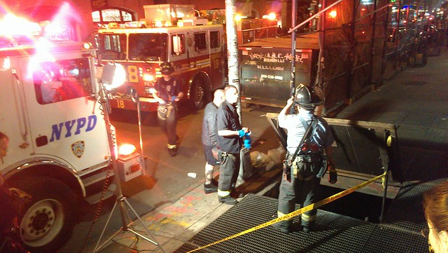 Emergency workers at the scene of the man hit by a subway train