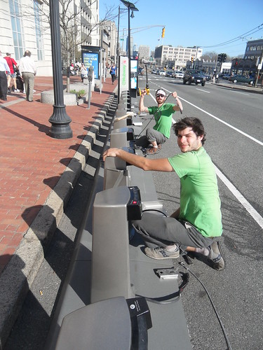Graham Conway(closest) and Galen Mook(farthest) install Hubway Station on Comm. Ave
