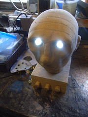 Testing animatronic head with wooden mains plug