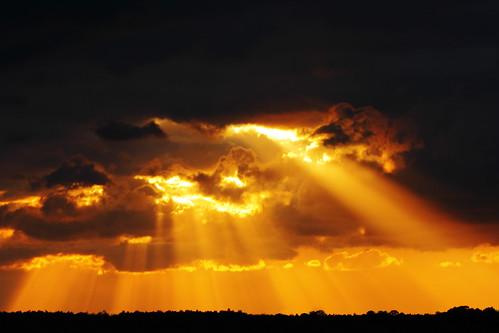 sunset orange storm clouds spring florida crepuscular