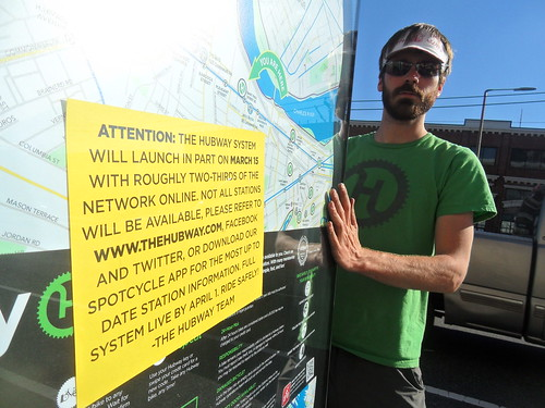 Galen Mook installs Hubway map and signs