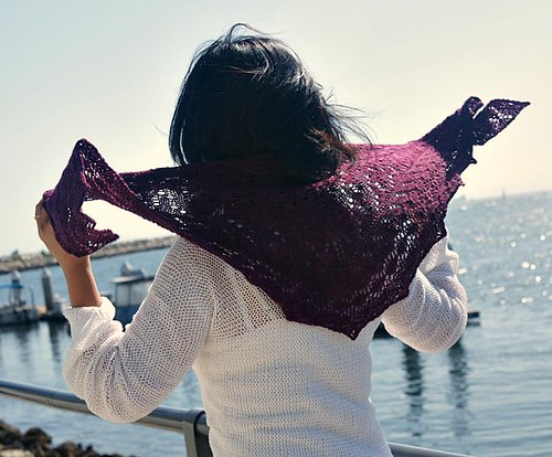 Mira Cole modeling the shawl knit with her yarn