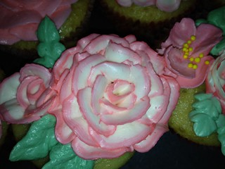 duo color frosting flowers on vanilla cupcakes