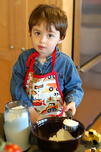 Will baking cookies in his new digger apron by Eve Fox, Garden of Eating blog, copyright 2012