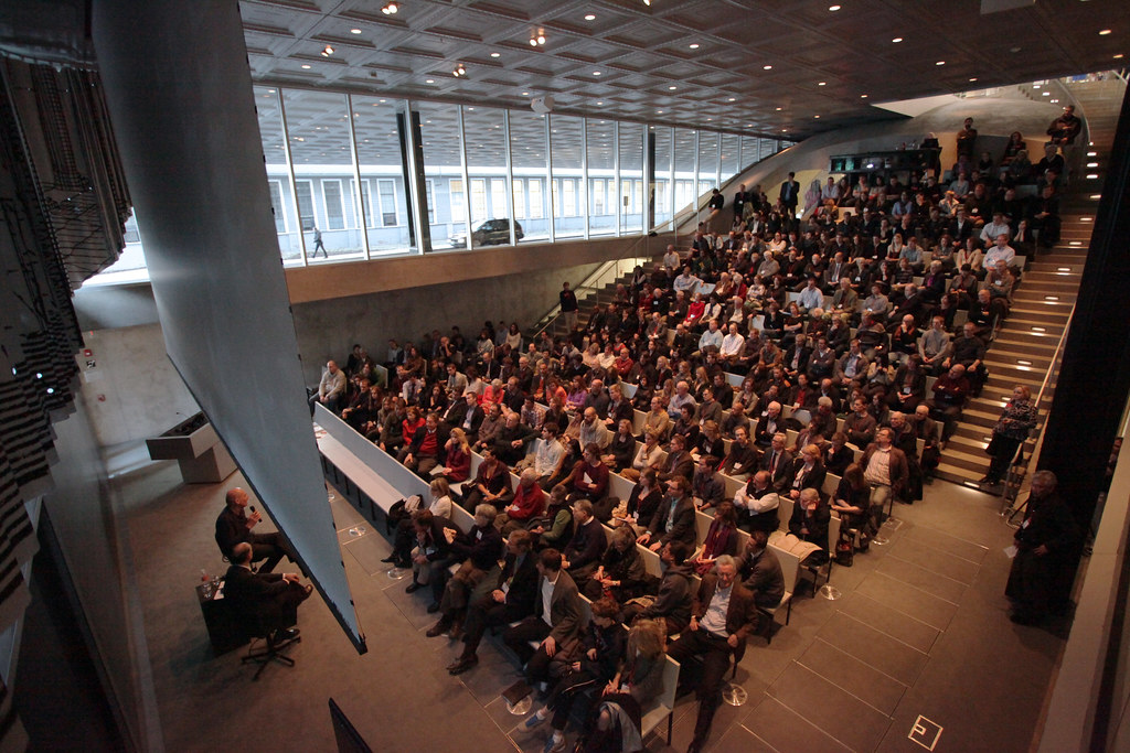 The view from the Abby and Howard Milstein Auditorium balcony showing Dean Kent Kleinman in conversation with Rem Koolhaas.