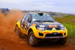 compact sport utility vehicle(0.0), world rally championship(0.0), auto racing(1.0), automobile(1.0), automotive exterior(1.0), rallying(1.0), racing(1.0), pickup truck(1.0), vehicle(1.0), truck(1.0), sports(1.0), off road racing(1.0), motorsport(1.0), off-roading(1.0), rallycross(1.0), rally raid(1.0), mitsubishi(1.0), off-road vehicle(1.0), bumper(1.0), land vehicle(1.0),