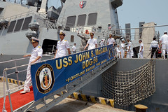 Officers of the Vietnam People's Navy depart USS John S. McCain (DDG 56) following a shipboard tour in Da Nang, April 7. (U.S. Navy/MC1 Jay C. Pugh)
