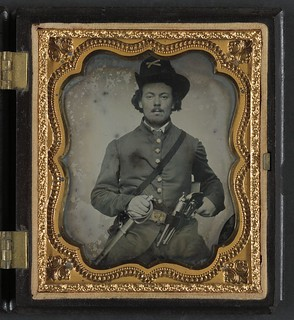 [Unidentified soldier in Union cavalry uniform with Colt Dragoon revolvers and sword] (LOC)