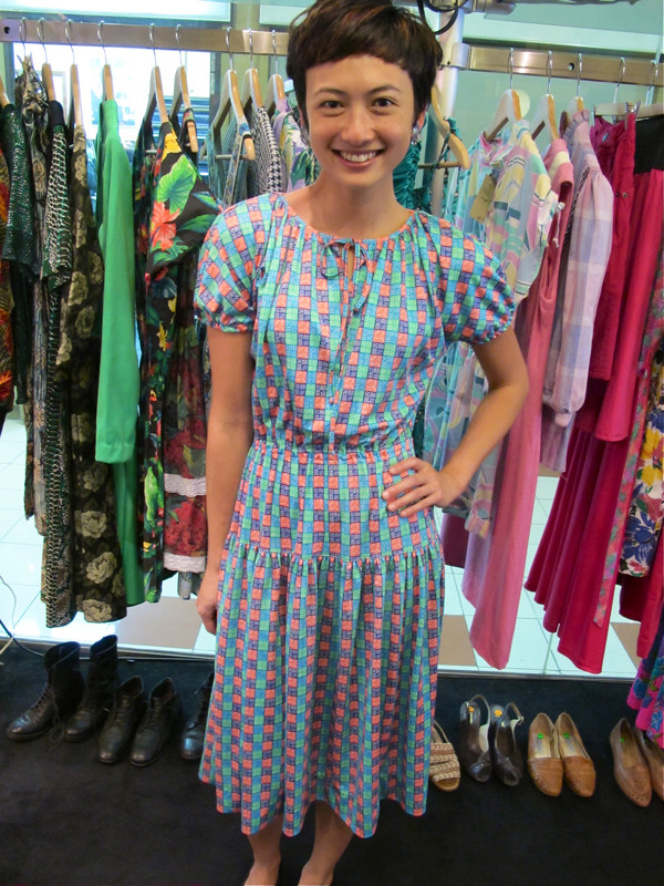 Its a French 1970s dress from Paris, in lovely hues of pink, green and blue. We dig!