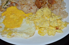 scrambled egg and fried egg cooked using non stick pan and tongs