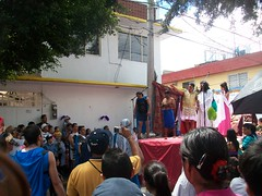 The group observes the re-enactment of Jesus' trial and crucifixion