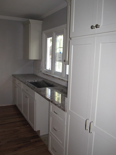 long view of pantry, dishwasher, sink