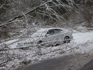 Car slides off highway in Lincoln County