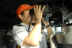 MANILA, Republic of the Philippines (March 23, 2012) Ensign Maria Veloria looks through binoculars in the pilothouse as USS Blue Ridge (LCC 19) arrives for a port visit. (U.S. Navy photo by Mass Communication Specialist 3rd Class Alexandra Arroyo)